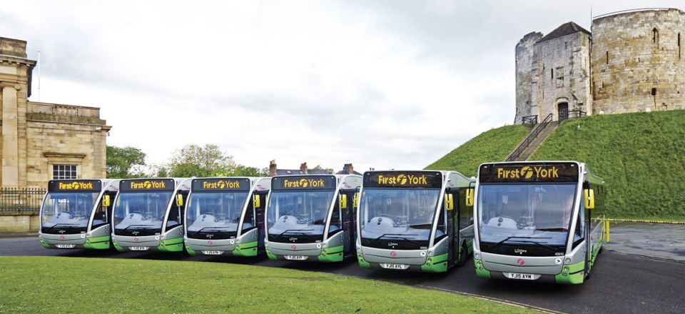 The six Optare Versa EVs for service 9 in front of Cliffords Tower