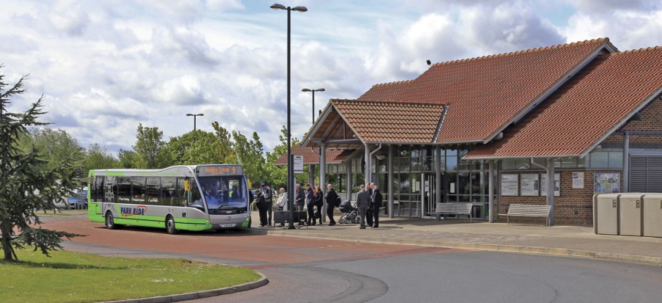 The substantial passenger building at Monks Cross P+R site with one of the Versa EVs taking on a full load