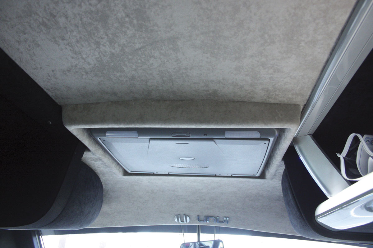 A 19in fold up monitor mounted in the headlining at the front is standard