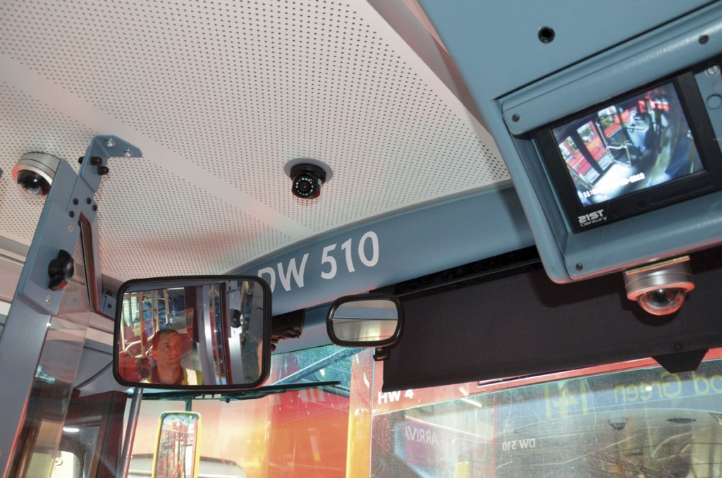 A 21st Century Technology CCTV system set up by the entrance of a bus