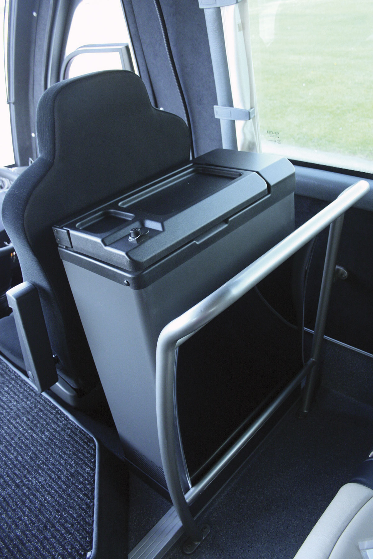 A neat fridge unit mounted behind the driver's seat is an option
