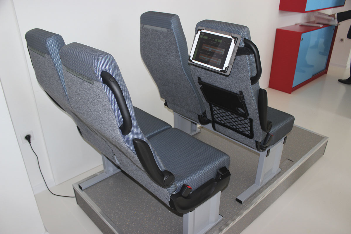 The adjustable seat spacing demonstration unit with seatback computer screen that shows the available options and combinations.