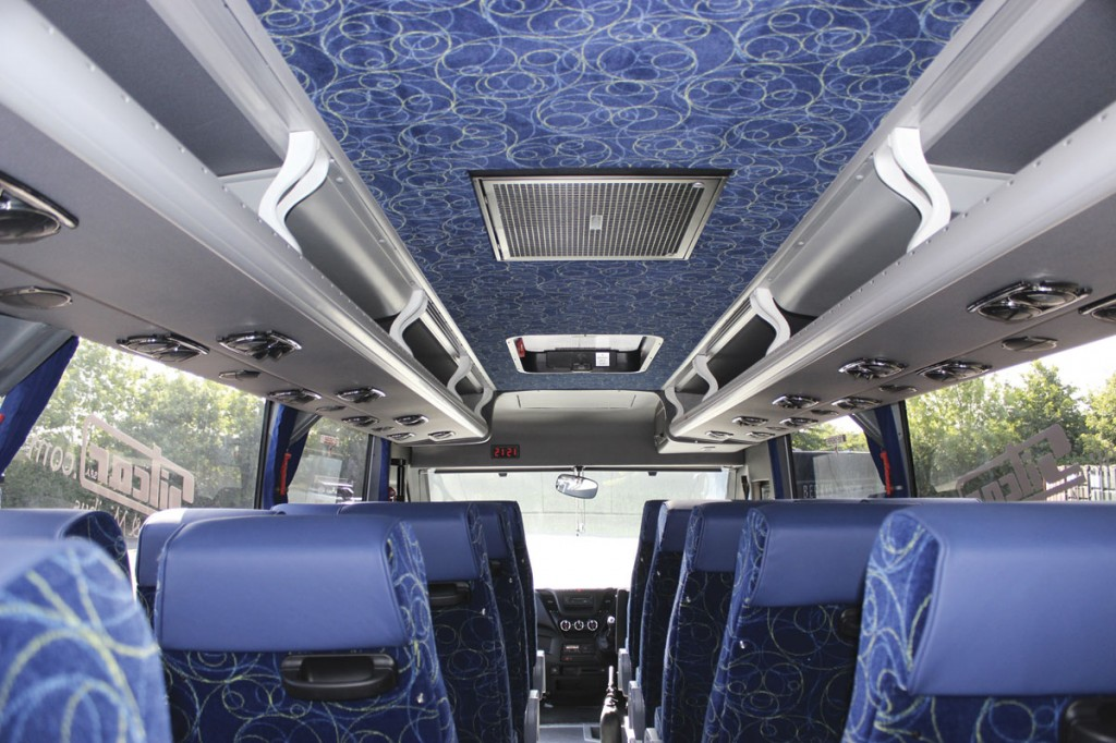 The interior from the rear of the saloon showing the ceiling and rack treatment