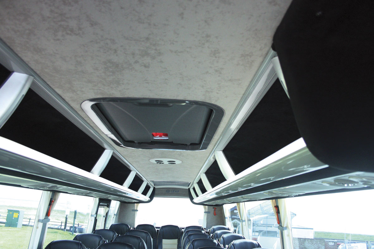 The new style slim line racks provide easy access plus the usual individual passenger service units and lighting. Note also the glazed roof hatch/emergency exit