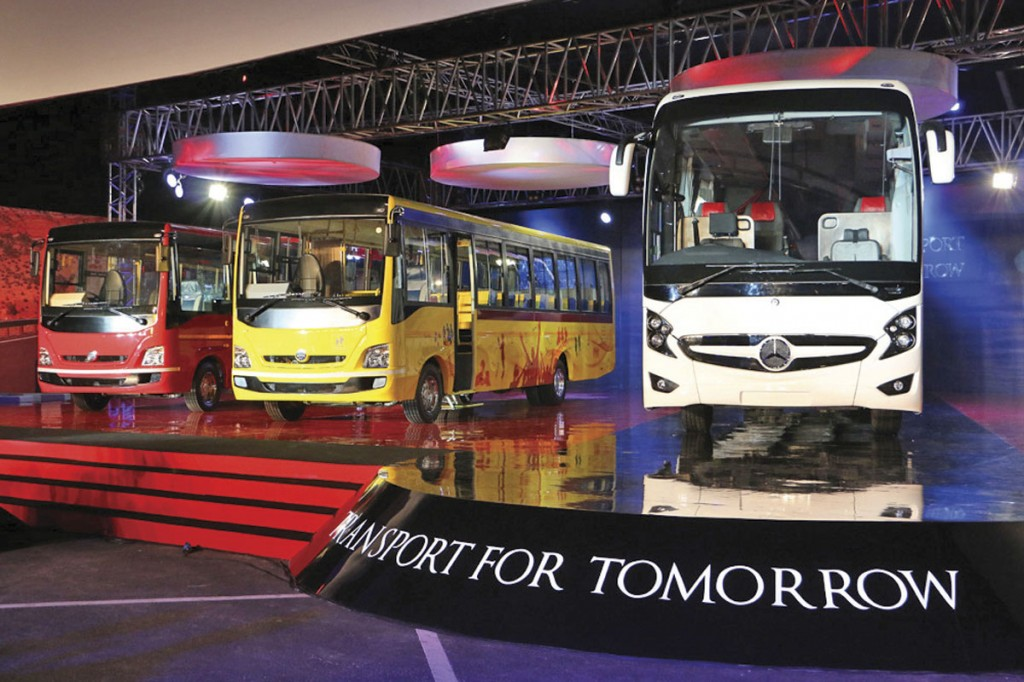 Wrightbus designed the aluminium bodywork for the range which includes tourist buses (red) and school buses (yellow). The white vehicle is a coach pic1
