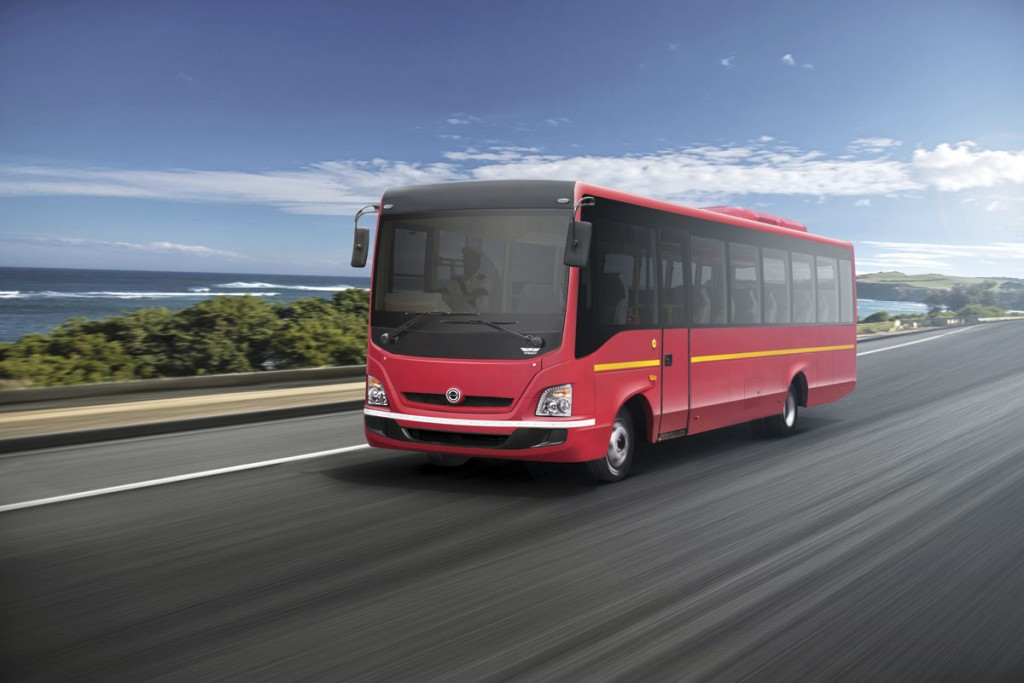 Wrightbus designed the aluminium bodywork for the range which includes tourist buses (red) and school buses (yellow). The white vehicle is a coach pic3