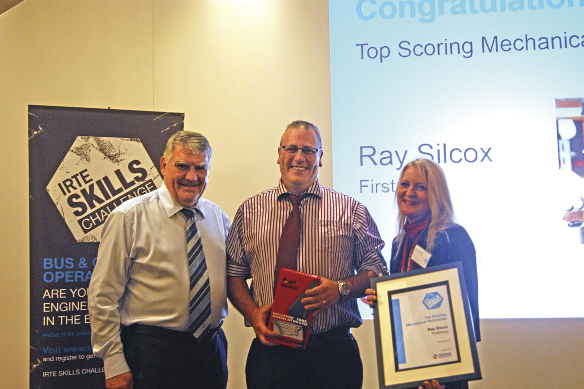 FirstGroup's Ray Silcox, Top Scoring Mechanical Technician receives his award with OEM Account and Business Development Manager at Allison Transmission, Patricia Ann Cobbold