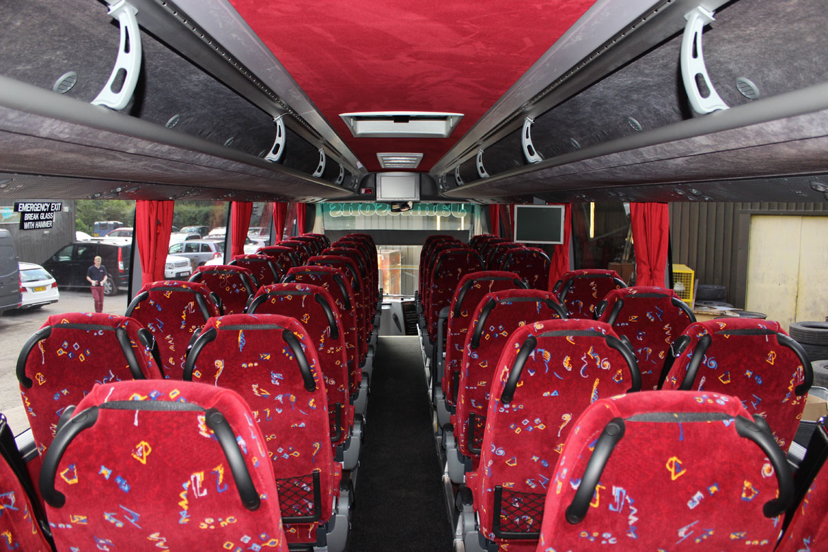 Moquette applied to the rear of the seats, coupled with the red ceiling centre strip and curtains give the Barbi HD a warm ambience