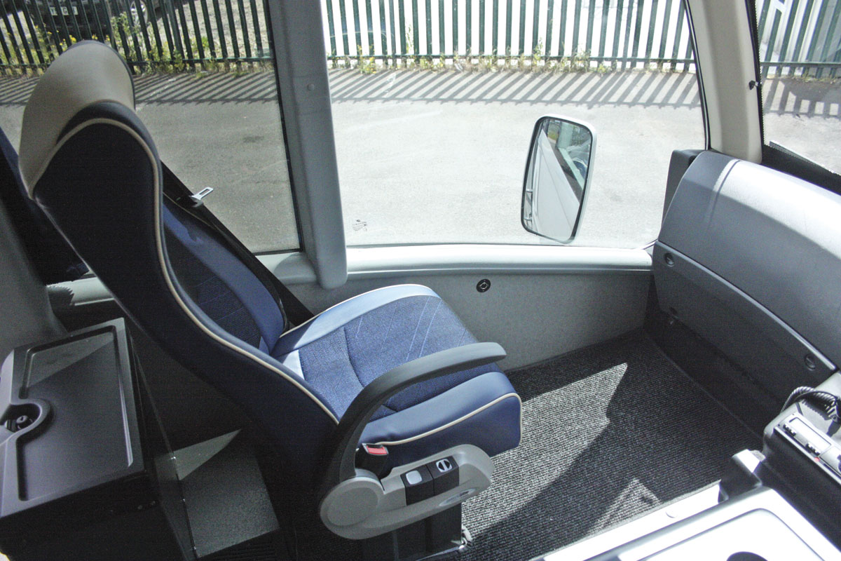 The front passenger seat alongside the driver matches those in the saloon