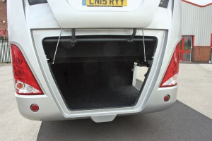 The large boot with parallel action door and access from rear and offside