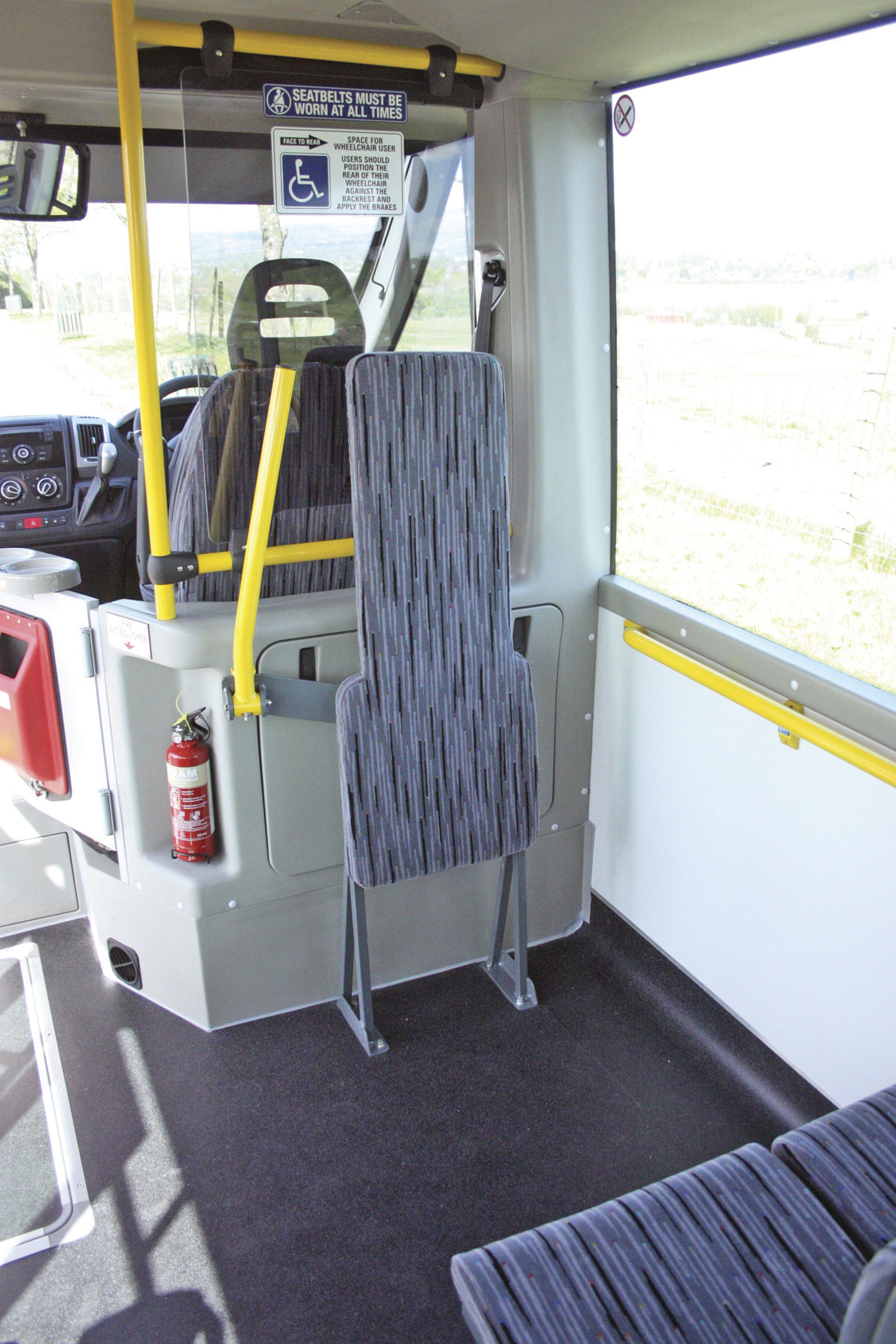 The wheelchair bay with ironing board back rest, lap belt and fold down security arm