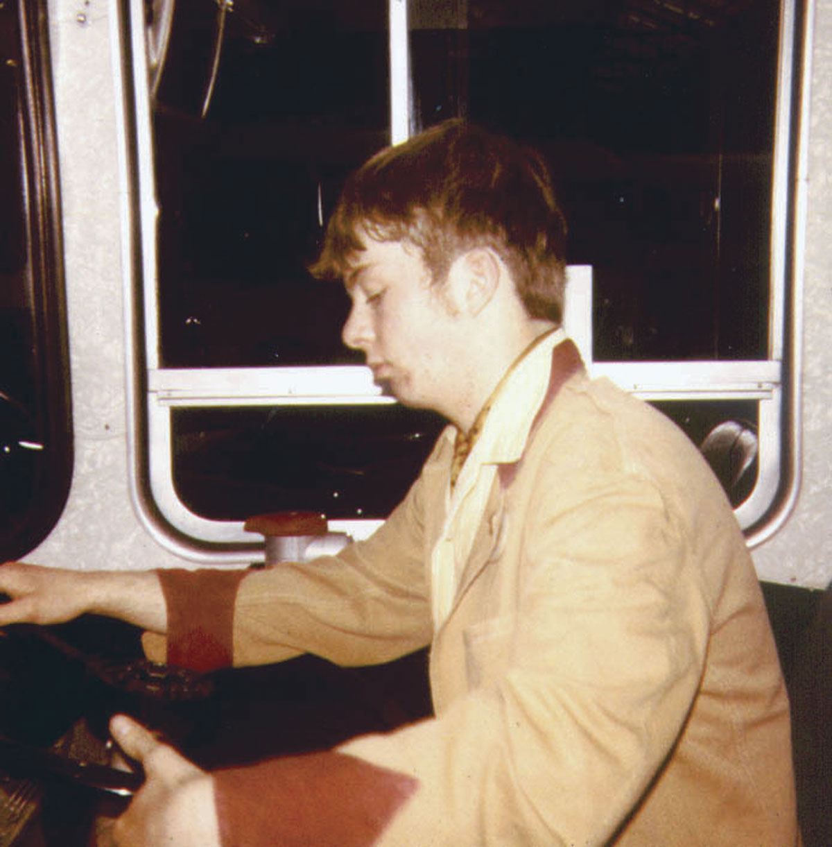 Ashley at 11yrs old sitting in a Leyland Panther of EYMS in Anlaby Road depot in Hull wearing a very old Midland Red summer uniform tunic