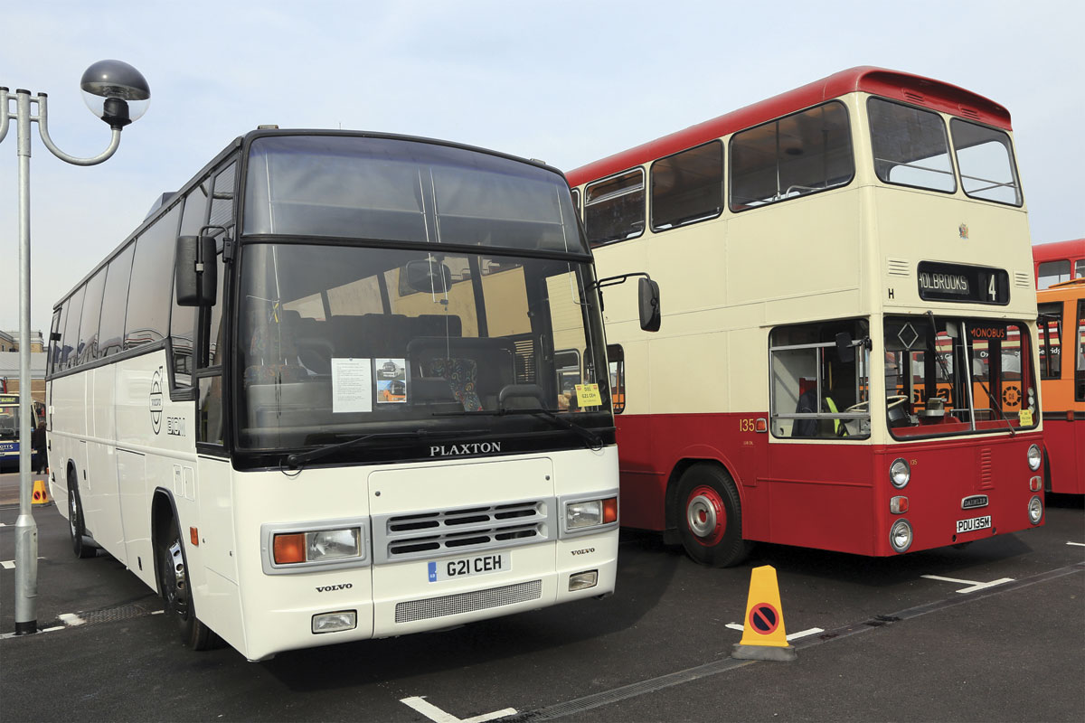 The Volvo B10M Plaxton Paramount returned to demonstration livery after service throughout England, Wales and Scotland is squeezed between one of the poles and a Daimler Fleetline restored in Coventry City Transport's final livery