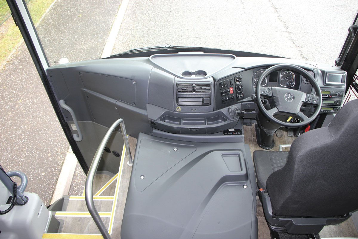 The forward section of the coach showing the seat and much of the dash retained from the standard Atego