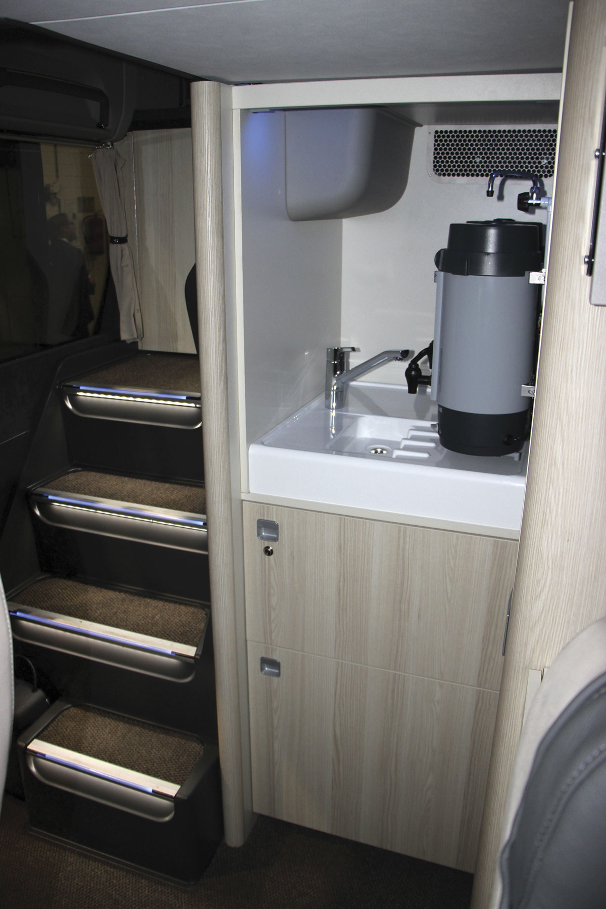 The servery unit at the rear of the lower deck saloon. Note the light coloured woods and the rounded corners. The tolet compartment is to the right