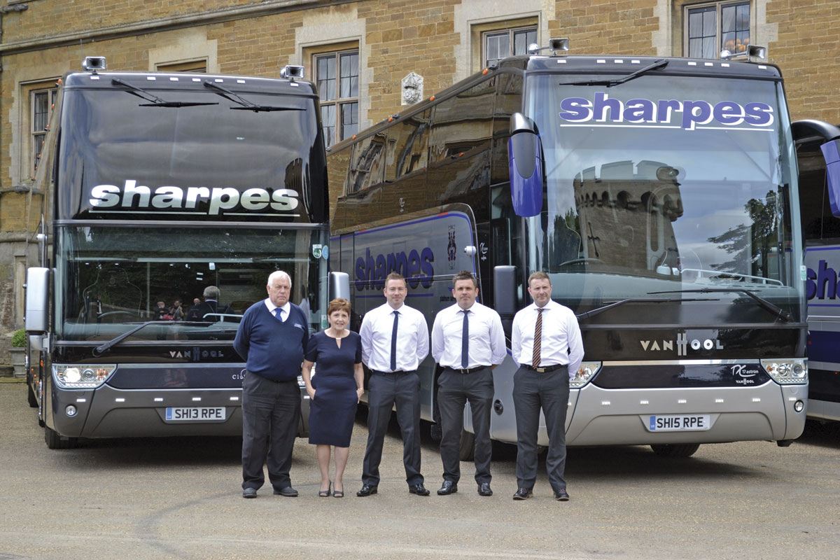 Trevor Sharpe with his wife Joy and three of his four sons, James, Neil and Russell in front of their Club Class Van Hool Altano TDX21 and Trevor's personal favourite, the Platinum class 2015 Van Hool Astron TX17