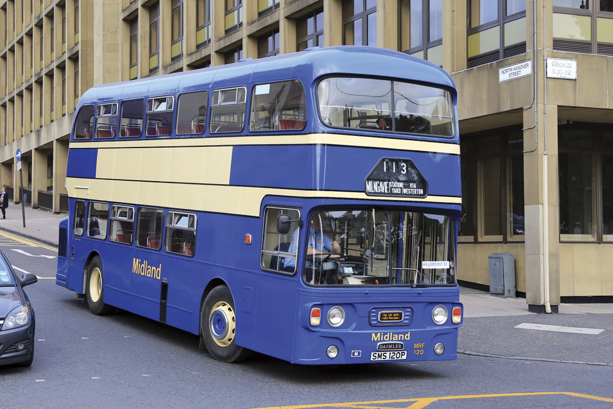 A 1976 Daimler Fleetline restored in Alexander Midland colours turns into Glasgow's George Square.