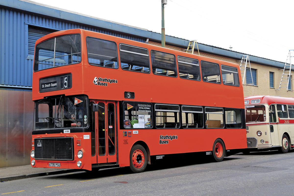 A 1983 Volvo Ailsa restored in Strathclyde's vivid orange and black livery.