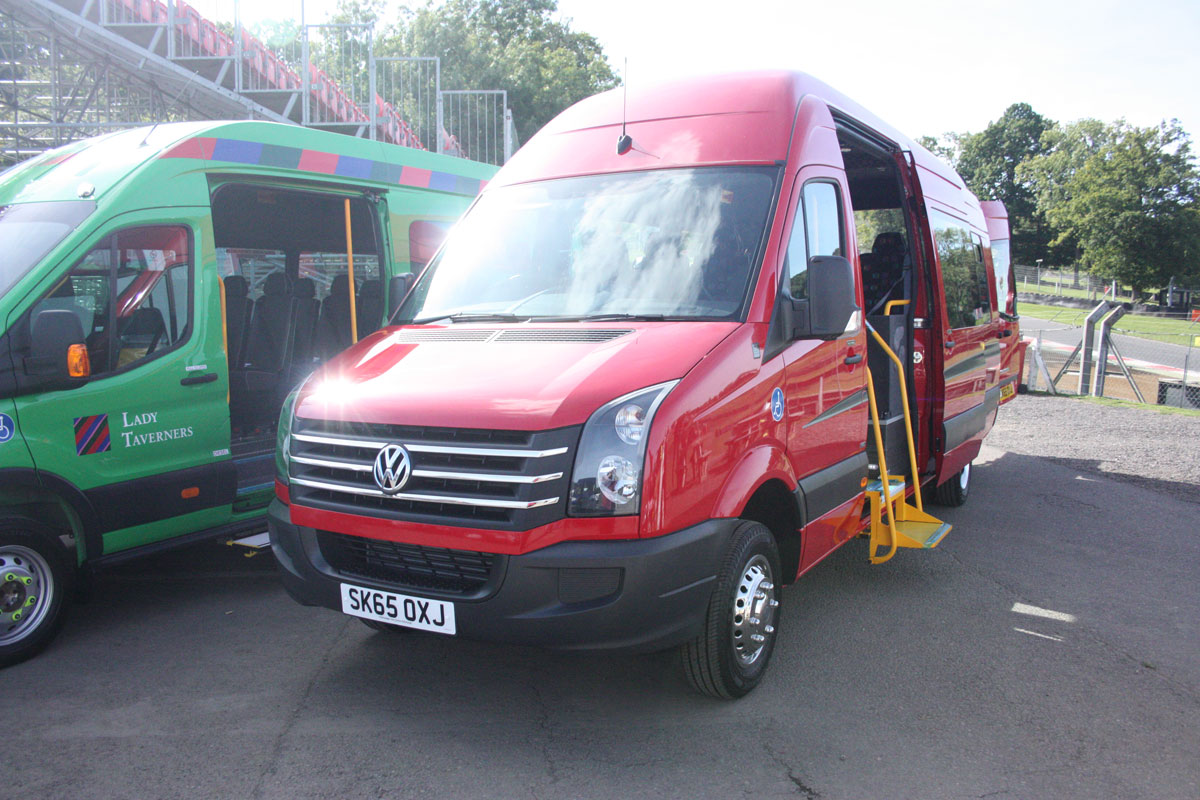 A VW Crafter CR50 accessible vehicle conversion with seating for 15 or, alternatively, four seated passengers and five wheelchairs.