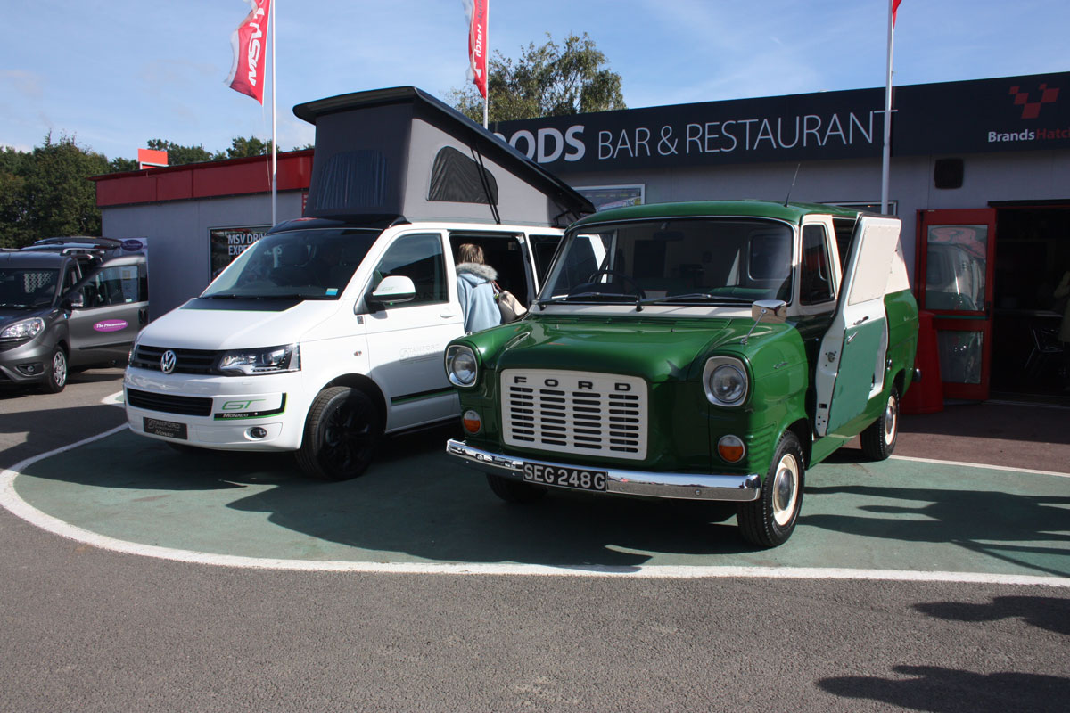 A new VW T5 Transporter motor home alongside a Transit motor home that Stanford converted from a 1969 Mark 1 Transit to commemorate their 20 years of converting vehicles.