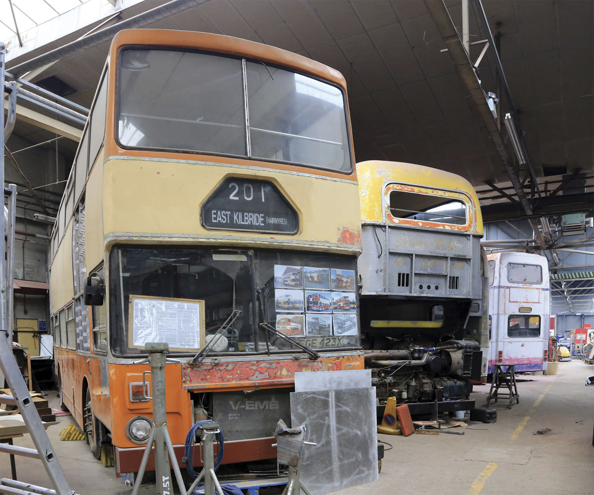 The closed off main workshop area with a variety of Alexander bodied vehicles under restoration.