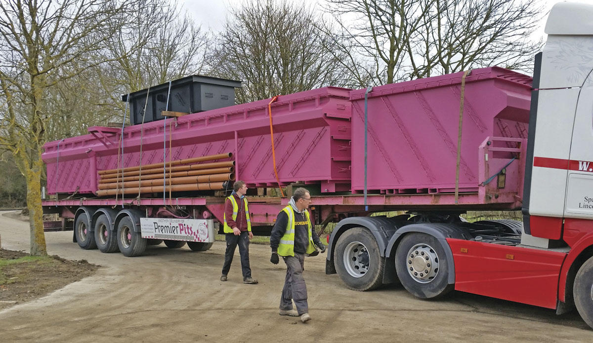 A Premier Pit is delivered for installation in the depot.