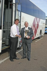 Matthew Haynes collecting silverware from Traffic Commissioner, Chris Heaps at the 2005 UK Coach Rally. The coach was new that year.