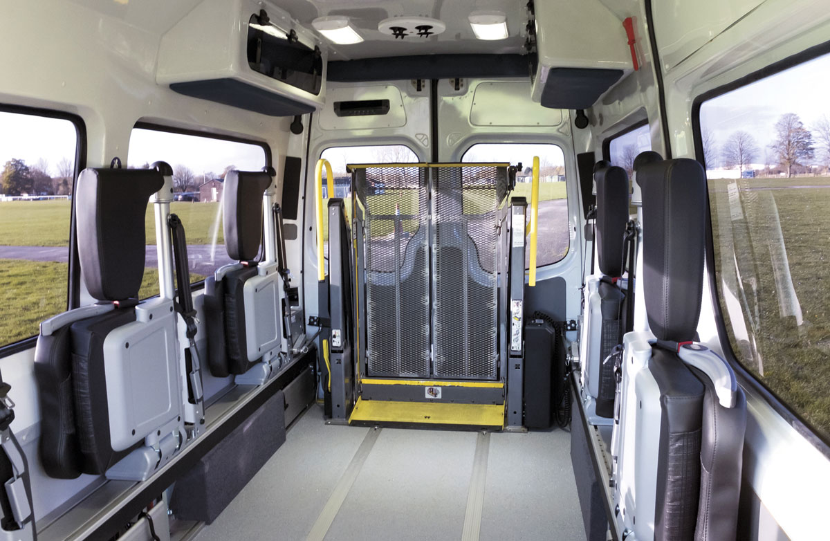 RolliBox with its seats folded away, making room for wheelchair spaces.