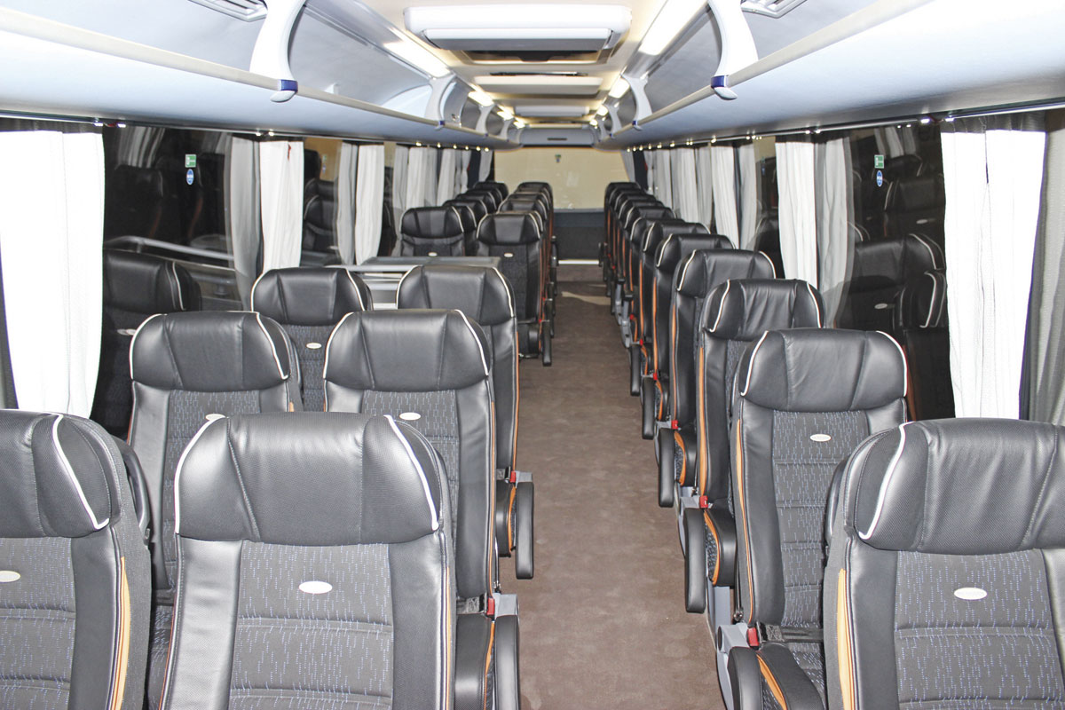 A new option is a 2+1 33-seat interior layout in the Neoplan Tourliner