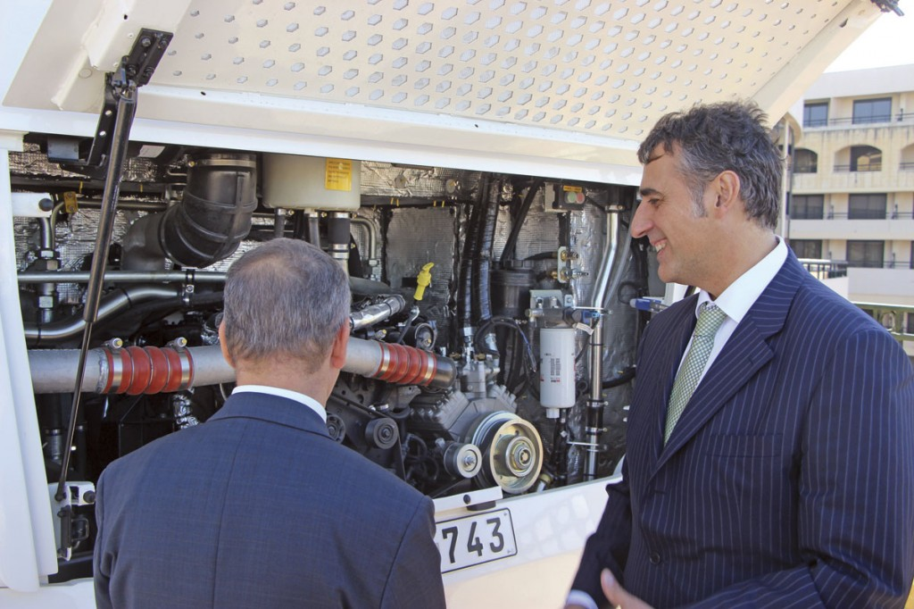 Felipe Cosmen, Chairman of MPT, showing Transport Minister, Joe Mizzi, the Vectio's six-cylinder Cummins engine