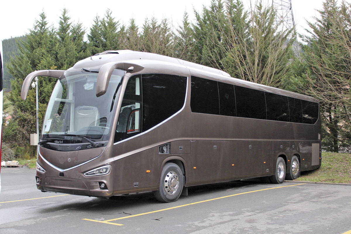 A left hand drive tri-axle i8 showing the dark tinted glazing