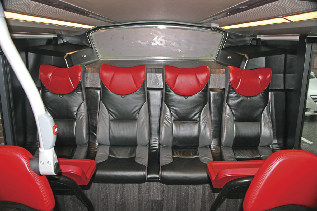 Four individual seats with tables at the rear of the lower saloon