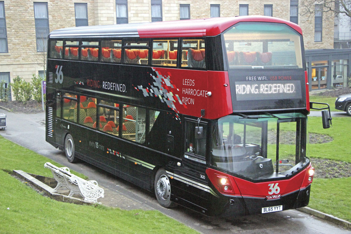 Seen at the Majestic Hotel prior to the launch, the bus features staircase windows. Note the red leather headrests