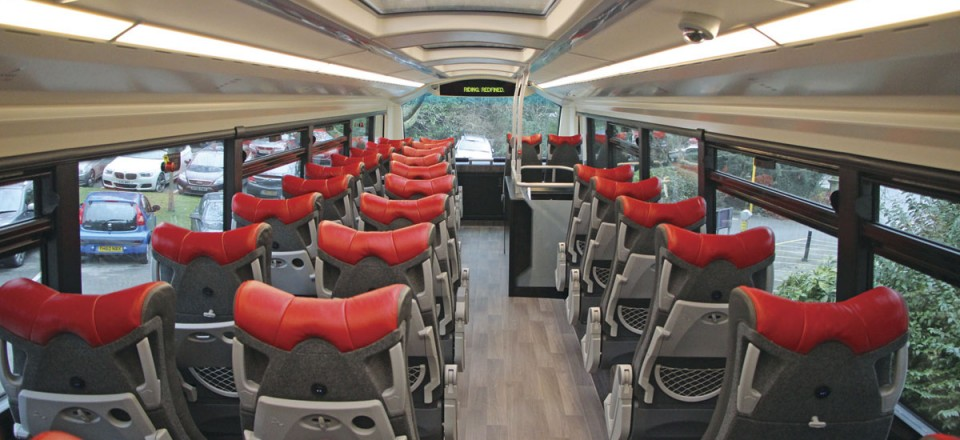 The full length glazed roof is a first for Wrightbus. Note the seat back tables and magazine nets. The side windows are double glazed