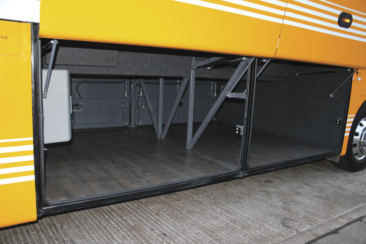 A large luggage hold is uncluttered and easily accessible through the cantilevered locker doors.
