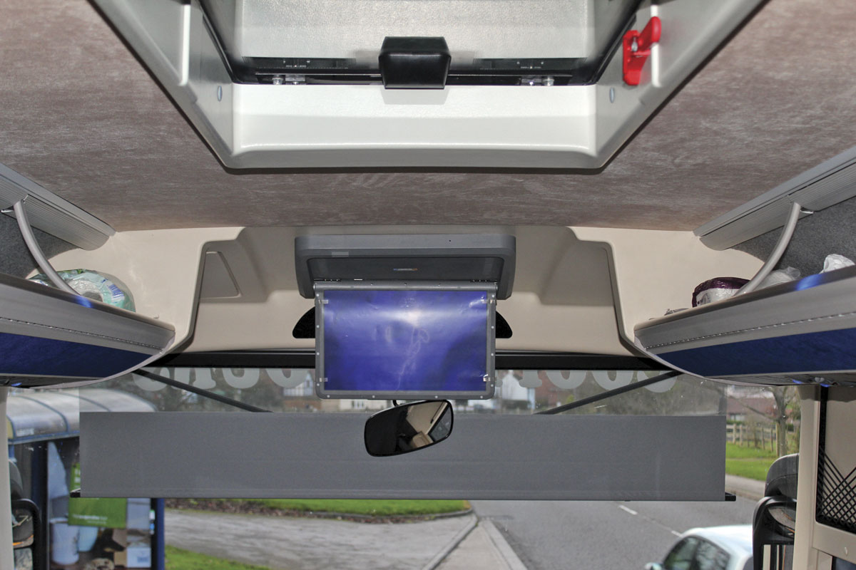 A powered drop-down monitor is provided at the front and there is a full width powered blind, though care has to be taken not to lower it too far or it obscures the nearside mirrors.