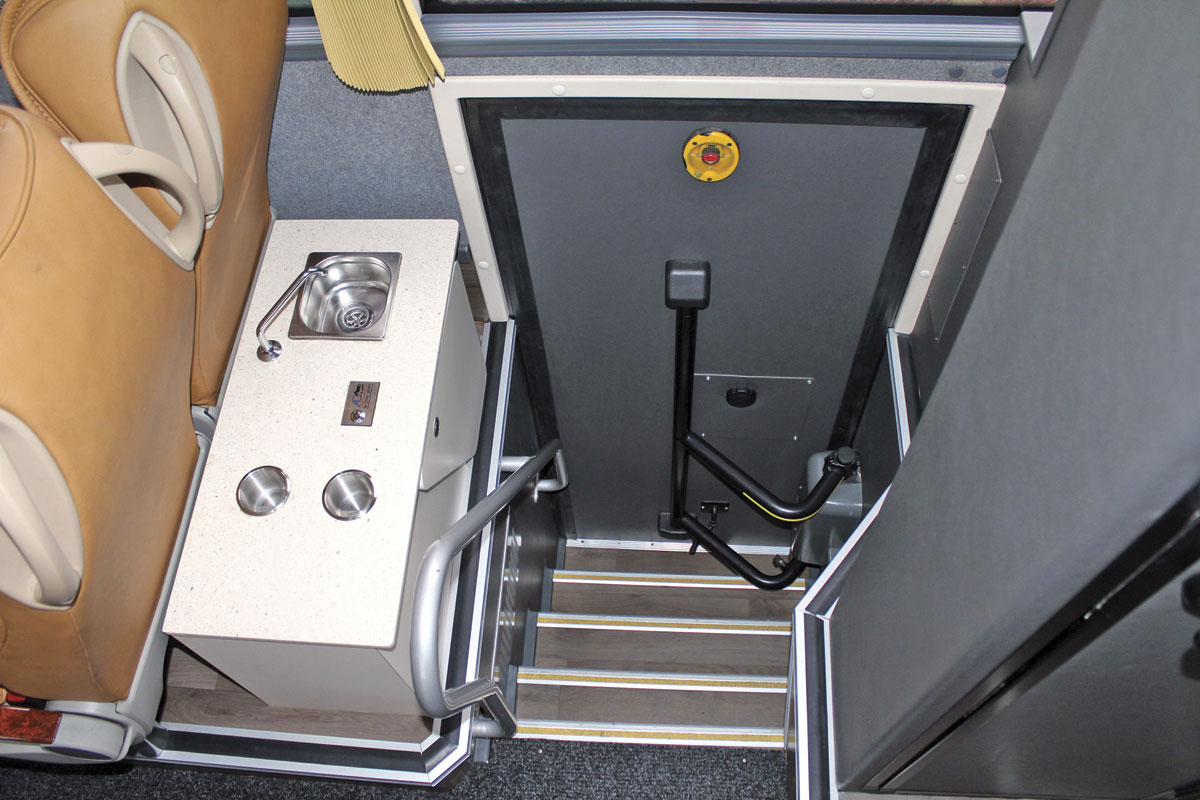 An AD Coach Systems servery is fitted to the left of the rear offside continental entrance. The toilet is to the right.