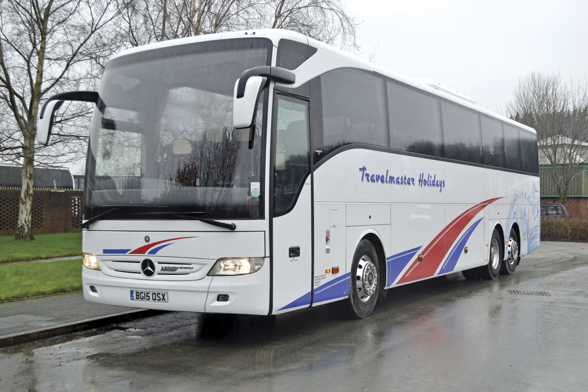 Owen's Travelmaster's most recent coaches; a 13m tri-axle Tourismo M