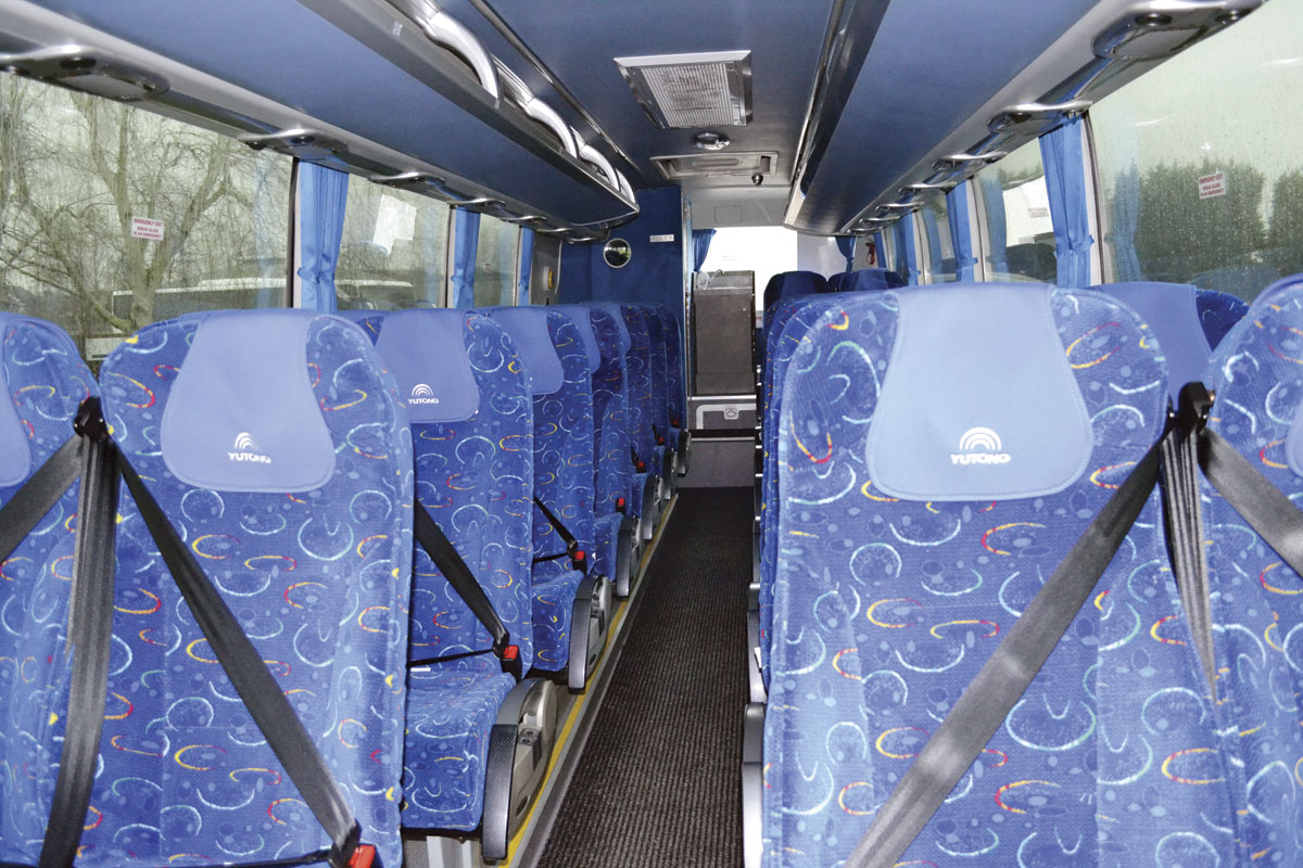 The 9m Yutong was fitted with seat belts and chair back tables