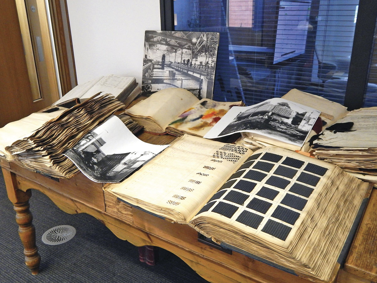 Old ledgers and sample books reflect on the company's rich heritage