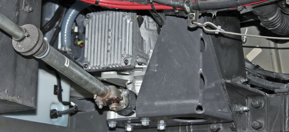 The electric motor powering the VDS system in situ beneath a Volvo 8900 in the workshops