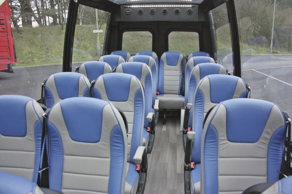 The interior seats 19 passengers plus courier.