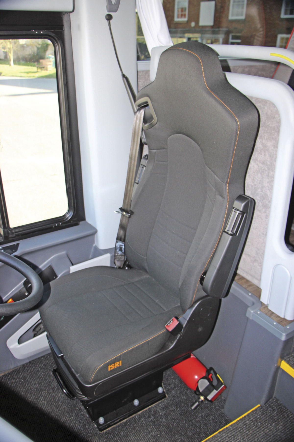 The standard driver's seat is a comfortable Isri air suspended unit
