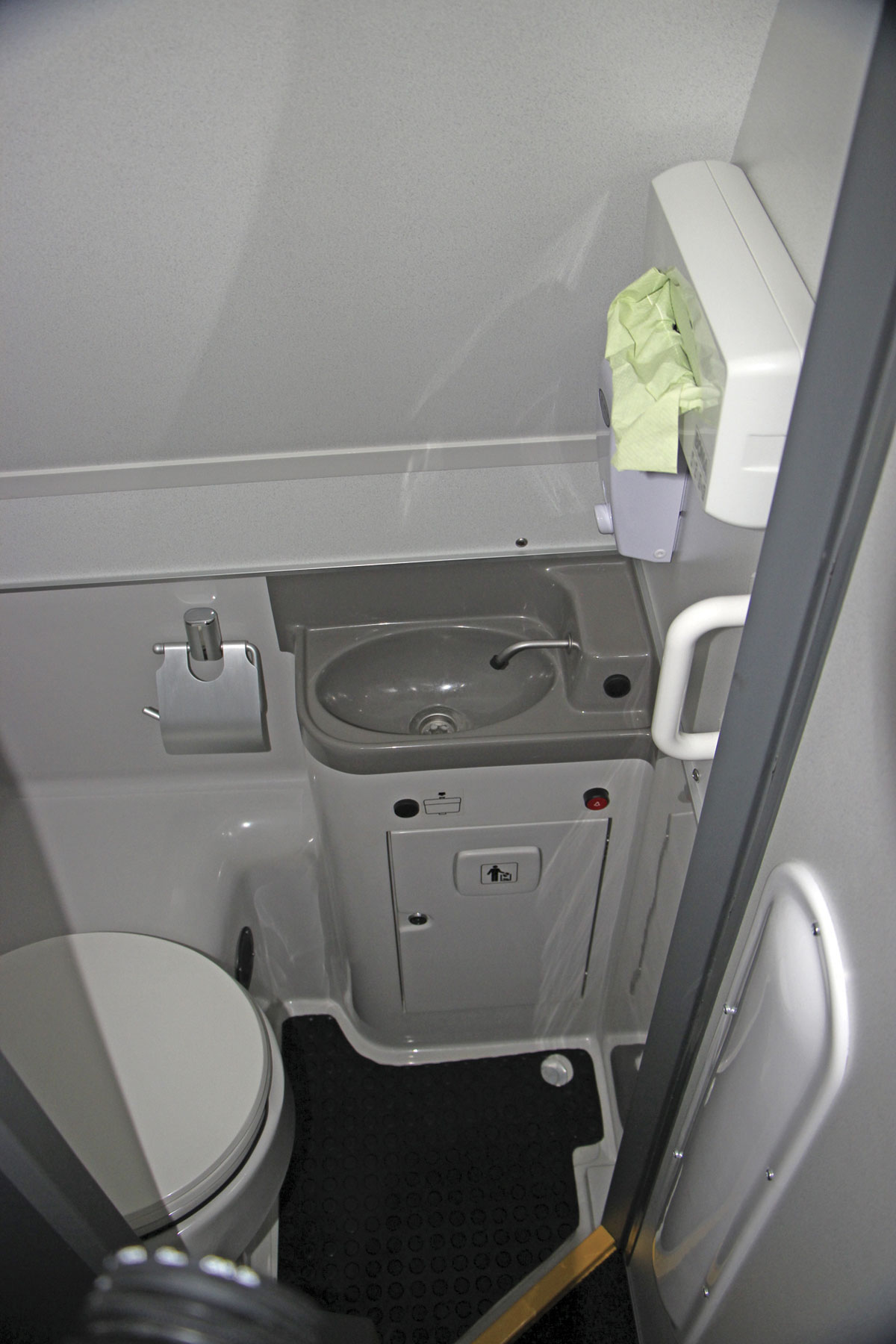 The toilet compartment has the seat mounted facing the offside rather than the rear, a layout also used in the TX