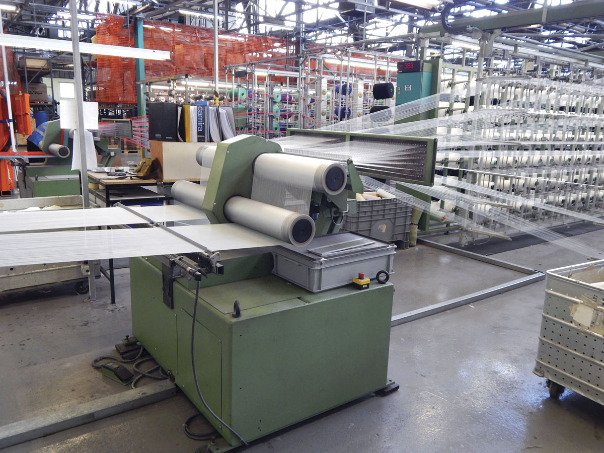 Yarn being wound onto warp beams