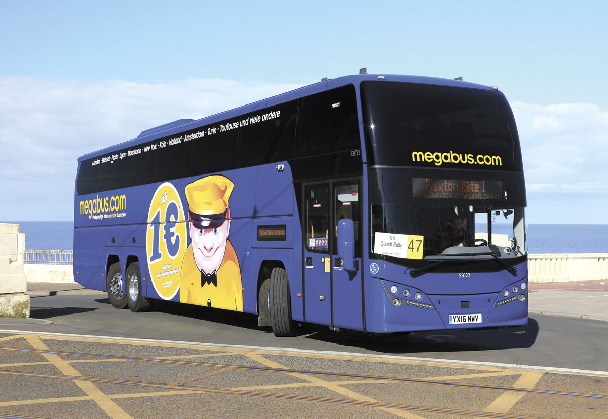 15m of Megabus Elitei, recipient of the Plaxton Trophy, takes the first tight turn across the tramway on the road run