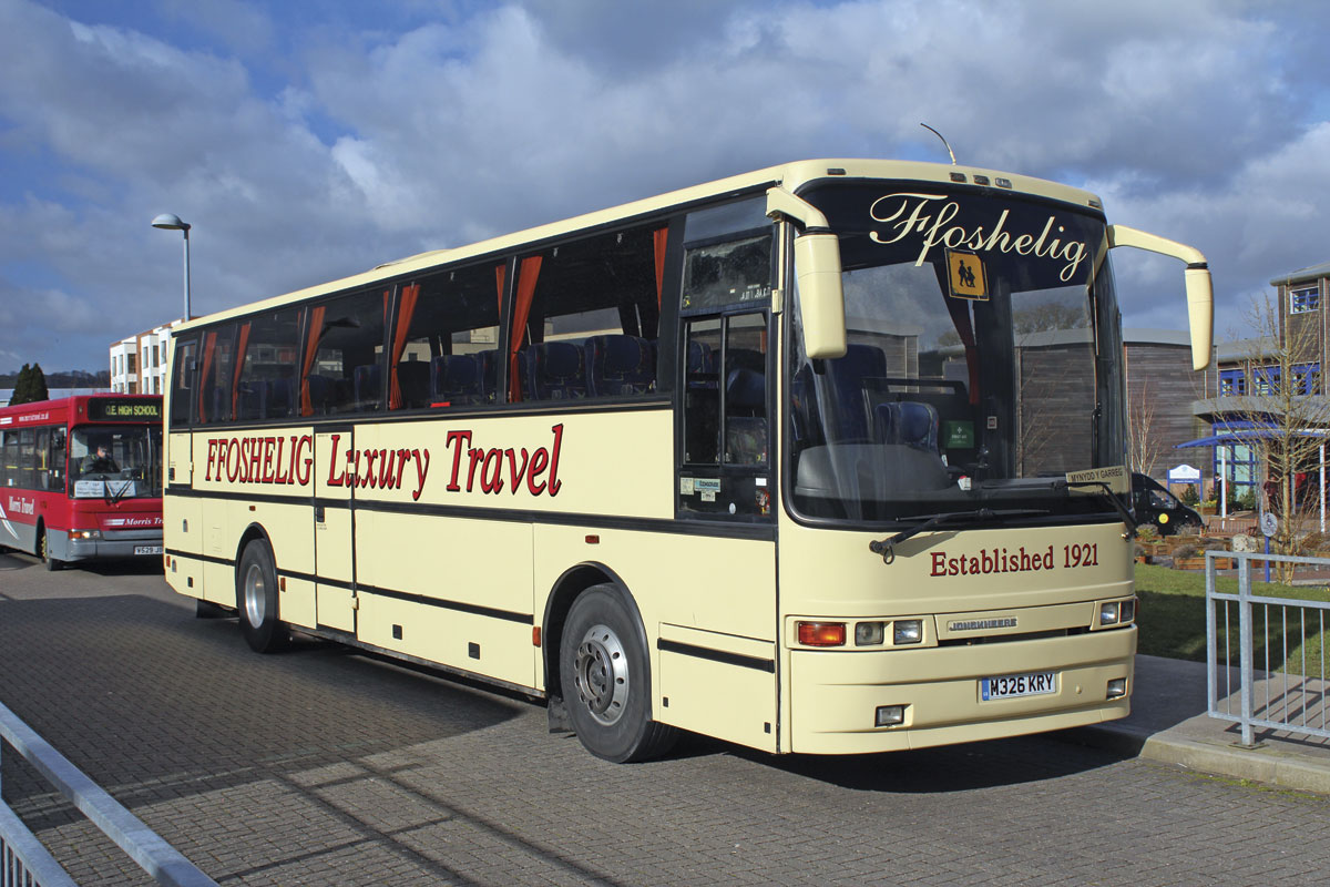 A Jonckheere Deauville Volvo B10M new to Clarkes is the spare coach, seen here on school contract duties. It is LEZ compliant