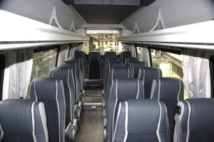 The interior of the Tourys featuring Lazzerini seats. The UK version will feature a sunken aisle, R66 rollover certification and 19 Kiel Avance seats.