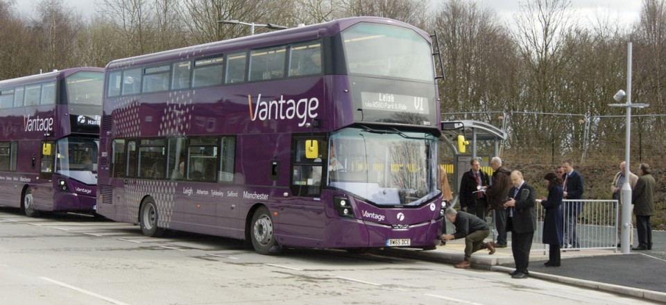 Two of the buses pulled up at one of the busway stops