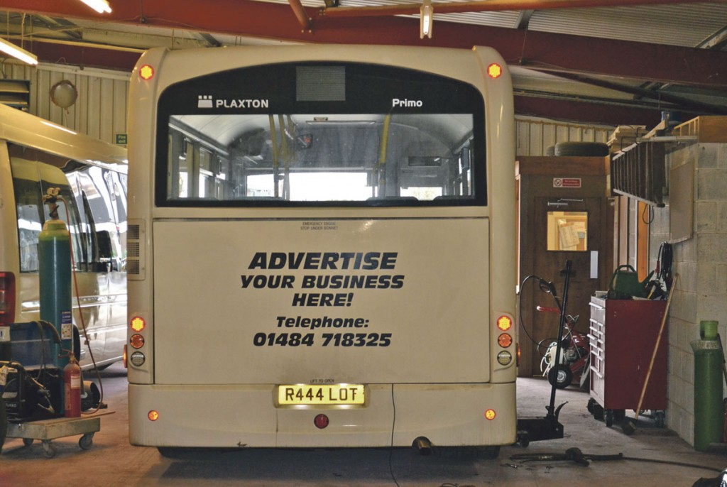 Bus advertising is an important additional revenue stream for the company. The workshop stores and office can be seen to the right of this picture and vehicle lifts have been purchased for when the pit is in use